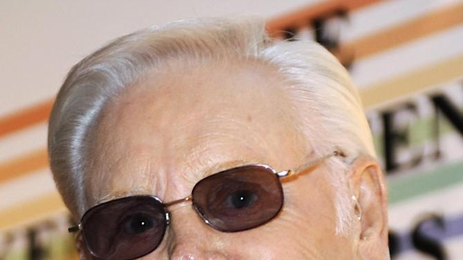 FILE - In this Dec. 7, 2008 file photo, George Jones arrives for the Kennedy Center Honors at the Kennedy Center in Washington. Jones is hospitalized in Nashville. Jones, 80, has been released from a Nashville area hospital after nearly a week of treatment for an upper respiratory infection. A statement from his publicist says Jones will be resting at home until his next concert on April 20 in Mahnomen, Minn. (AP Photo/Jacquelyn Martin, File)