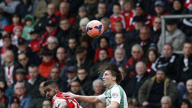 Yeovil Town's Luke Ayling, right, and Southampton's Guly Do Prado battle for the ball during their FA Cup fourth round soccer match at St Mary's, Southampton, England, Saturday, Jan. 25, 2014