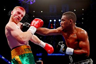 Daniel Jacobs (R) connects on a punch to the face of Chris Fitzpatrick on December 1, 2012. (Getty)