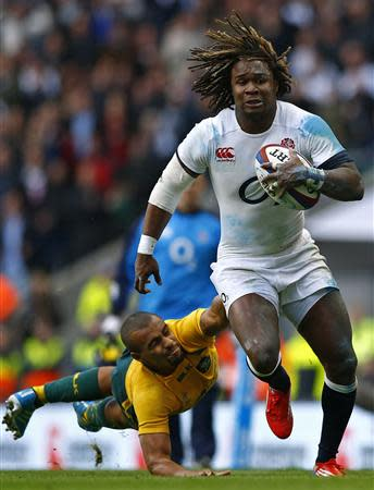 England's Yarde evades a tackle from Australia's Genia during their international rugby union match in London