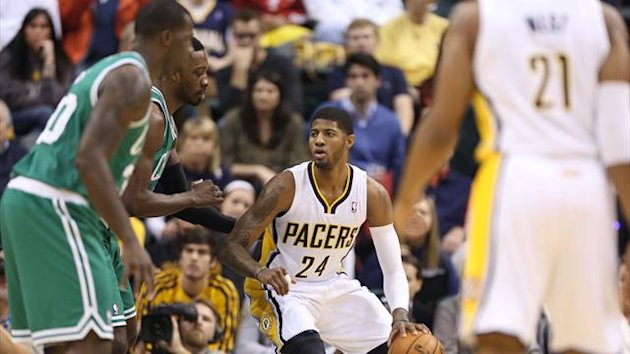 Indiana Pacers forward Paul George (24) drives baseline against the Boston Celtics (Reuters)