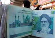 Iranian rial banknotes bearing a portrait of the late founder of the Islamic Republic of Iran, Ayatollah Ruhollah Khomeini. Beijing reacted furiously Wednesday to new US sanctions imposed on a Chinese bank over transactions with Iran, urging Washington to revoke them and saying it would lodge an official protest