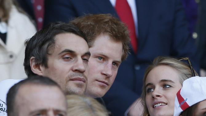 Britain's Prince Harry reacts before England's Six Nations international rugby union match against Wales at Twickenham in London