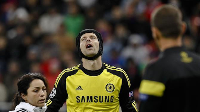 Chelsea goalkeeper Petr Cech, centre,  reacts after an injury during the soccer Champions League group E match between Steaua Bucharest and Chelsea in Bucharest, Romania, Tuesday, Oct. 1, 2013