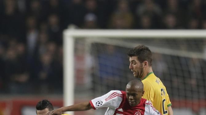 Ajax's Stefano Denswil, center, Celtic's Emilio Izaguirre, left, and Celtic's Charlie Mulgrew, right, vie for the ball during the Champions League Group H soccer match between Ajax Amsterdam and Celtic Glasgow at ArenA stadium in Amsterdam, Netherlands, Wednesday, Nov. 6, 2013