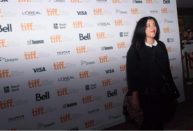 "Director Marjane Satrapi poses on the red carpet her new movie ""The Voices"" during the 2014 Toronto International Film Festival in Toronto on Thursday, Sept. 11, 2014. Capturing a lonely sch"