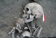 This handout photo, provided by the Bulgarian National Institute of Archeology, shows the remains of a man with a ceramic bowl in the necropolis of a small settlement made of two-story houses near the town of Provadia in eastern Bulgaria. Archeologists have uncovered the remains of what could be the oldest prehistoric city in Europe