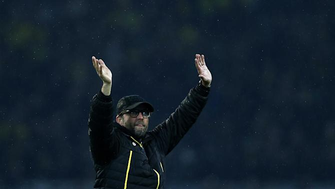 Dortmund head coach Juergen Klopp waves to supporters after his team won the German first division Bundesliga soccer match between  BvB Borussia Dortmund and VfB Stuttgart  in Dortmund, Germany, Friday, Nov. 1, 2013