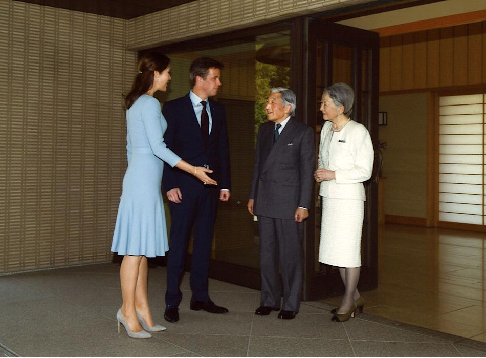 In this photo released by The Imperial Household Agency of Japan, Danish Crown Prince Frederik, second left, accompanied by Danish Crown Princess Mary, left, chats with Japanese Emperor Akihito, secon