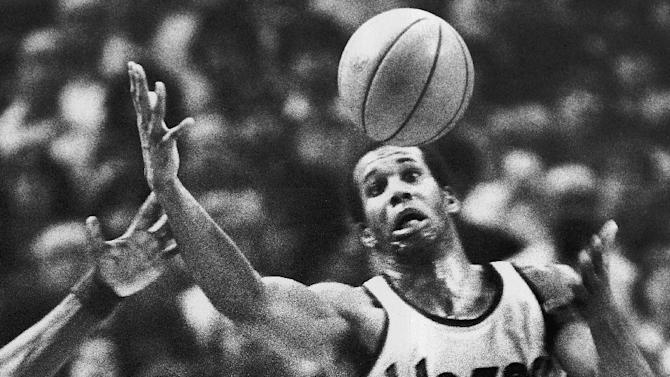 FILE - In this Dec. 25, 1979, file photo, Portland Trail Blazers'  Kermit Washington gains control of a loose ball during an NBA basketball game against the Golden State Warriors in Portland, Ore. Washington, who notoriously gave a bone-breaking face punch to the Houston Rockets' Rudy Tomjanovich during a 1977 Lakers game, has been arrested by federal agents. Washington was arrested on a warrant Tuesday, May 24, 2016, in Los Angeles. Officials won't discuss the arrest, but they have set a news conference for Wednesday in Kansas City, Mo. (AP Photo/Jack Smith, File)