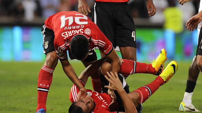 Benfica's Ezequiel Garay, left, celebrates the goal from Oscar Cardozo, below, against Vitoria Guimaraes in a Portuguese League soccer match at D. Afonso Henrique stadium in Guimaraes, Portugal, Sunday, Sept. 22, 2013. Benfica won 1-0