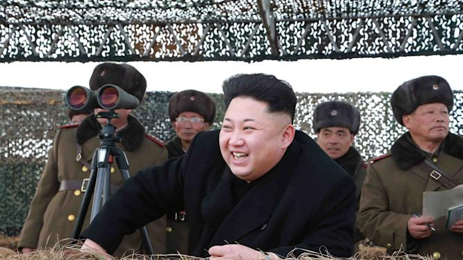 North Korean leader Kim Jong Un laughs as he watch a winter river-crossing attack drill of the armored infantry sub-units of the motorized strike group in the western sector of the front of the KPA