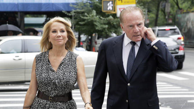 "Television host Kathie Lee Gifford and her husband Frank Gifford arrive for the funeral of Marvin Hamlisch, in New York's Temple Emanu-El, Tuesday, Aug. 14, 2012. Hamlisch composed or arranged hundreds of scores for musicals and movies, including ""A Chorus Line"" on Broadway and the films ""The Sting,"" ''Sophie's Choice,"" ''Ordinary People"" and ""The Way We Were."" He won three Oscars, four Emmys, four Grammys, a Tony, a Pulitzer and three Golden Globes. Hamlisch died Aug. 6 in Los Angeles at age 68. (AP Photo/Richard Drew)"