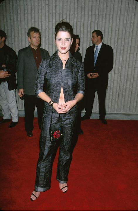 Neve Campbell in a midriff-baring ensemble