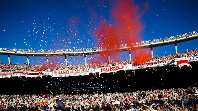 River Plate fans light flares when their team enters the field before an Argentina's league soccer match against Boca Juniors in Buenos Aires, Argentina, Sunday, Oct. 6, 2013. Boca Juniors won 1-0