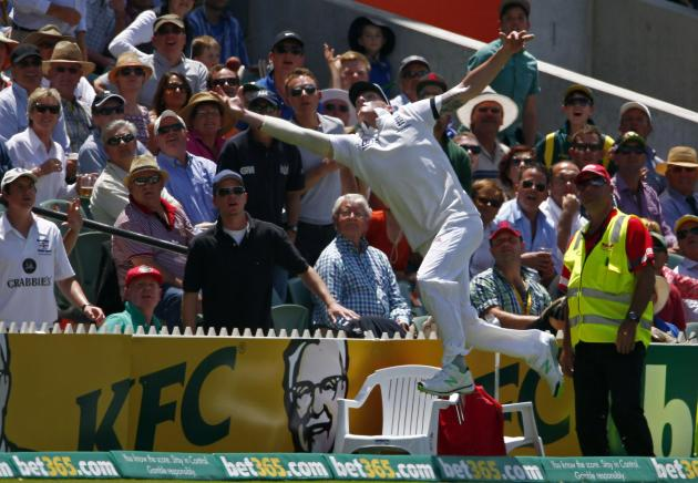England's Stokes jumps for an unsuccessful catch hit by Australia's Haddin during the second day's play in the second Ashes cricket test at the Adelaide Oval