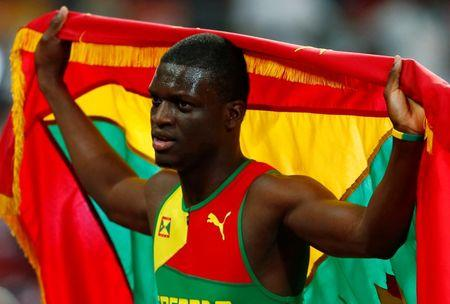 James holds his national flag after placing third in the men's 400 metres final at the IAAF World Championships in Beijing