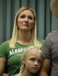 "Kellie Houston, neice of Cliven Bundy, cries after speaking at a public meeting in the Moapa Valley Community Center in Overton, Nev. Wednesday, April 9, 2014. The meeting was about the roundup by the Bureau of Land Management's of what they call ""trespass cattle"" run by Cliven Bundy in the Gold Butte area 80 miles northeast of Las Vegas. (AP Photo/Las Vegas Review-Journal, John Locher)"