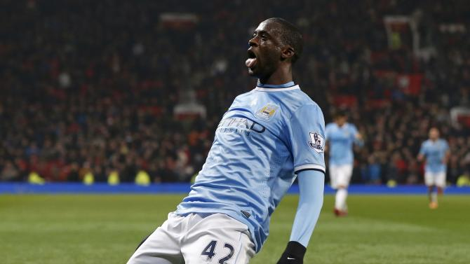 Manchester City's Toure celebrates his goal against Manchester United during their English Premier League soccer match in Manchester