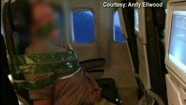 Raging Airplane Passenger Duct Taped to Seat