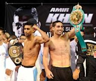 Britain's Amir Khan (L) and American Danny Garcia at the official weigh-in on July 13 in Las Vegas. Khan and undefeated Garcia meet in a light-welterweight title unification showdown on Saturday with each fighter seeking a victory to launch him to another level