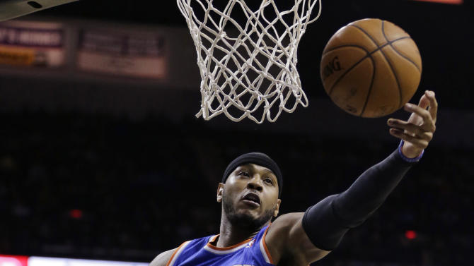 New York Knicks' Carmelo Anthon reaches for a rebound against the San Antonio Spurs during the first half on an NBA basketball game, Thursday, Jan. 2, 2014, in San Antonio