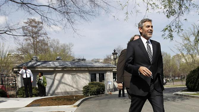 Actor George Clooney walks to talk with reporters outside the White House in Washington, Thursday, March 15, 2012, after a meeting with President Barack Obama. (AP Photo/Pablo Martinez Monsivais)