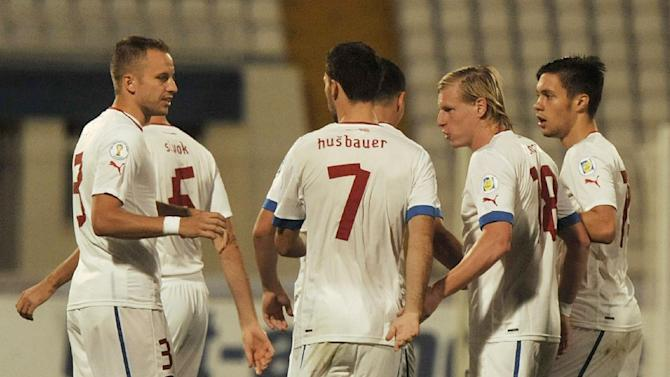 Czech players celebrate after scoring during the World Cup Group B qualifying soccer match between Malta and Czech Republic at National Stadium Ta' Qali in Valletta, Malta, Friday, Oct. 11, 2013
