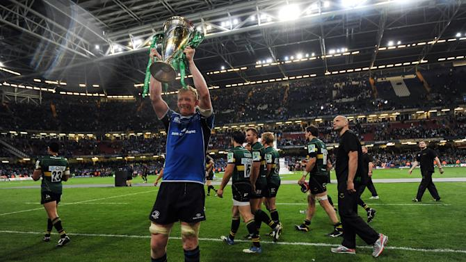 Leinster's Irish lock Leo Cullen holds the trophy as he celebrates after winning their Heineken Cup Final match against Northampton Saints at the Millennium Stadium in Cardiff on May 21, 2011.  AFP PHOTO / GLYN KIRK NOT FOR MARKETING OR ADVERTISING USE/RESTRICTED TO EDITORIAL USE (Photo credit should read GLYN KIRK/AFP/Getty Images)