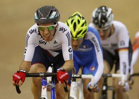 Britain's Yates rides to his gold medal during the men's points race at the 2013 UCI Track Cycling World Championships in Minsk