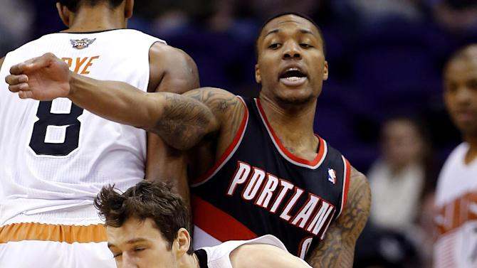 Portland Trail Blazers' Damian Lillard, rear, defends against Phoenix Suns' Goran Dragic, of Slovenia, during the first half of an NBA basketball game, Wednesday, Nov. 27, 2013, in Phoenix