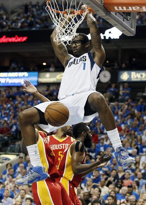 Dallas Mavericks' Amar'e Stoudemire (1) dunks against the Houston Rockets in the second half of Game 4 in an NBA basketball first-round playoff series Sunday April 26, 2015, in Dallas. (AP Pho