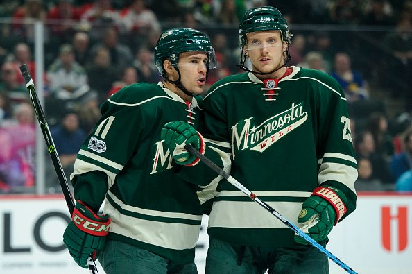 ST PAUL, MN - JANUARY 12: Zach Parise #11 and Jonas Brodin #25 of the Minnesota Wild speak during the first period of the game against the Montreal Canadiens on January 12, 2017 at Xcel Energy Center in St Paul, Minnesota. (Photo by Hannah Foslien/Getty Images)