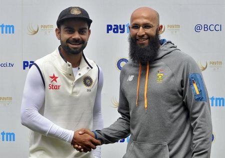 India's captain Kohli shakes hands with the South African captain Amla after their second cricket test match was called off due to rain and wet outfield in Bengaluru