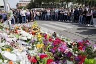 Flowers are displayed outside the Francesca Laura Morvillo Falcone school on May 21 2012 in Brindisi, ahead of Melissa Bassi's funeral. Italian police on Wednesday arrested the alleged perpetrator of a May 19 school bombing in the southern city of Brindisi that killed a teenage girl and shocked the nation, ANSA news agency said