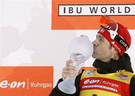 Ole Einar Bjorndalen of Norway kisses his World Cup trophy after winning this season's men's 12.5 km pursuit at the Biathlon World Cup Final in the Siberian town of Khanty-Mansiysk, 2,000 km (1,243 miles) east of Moscow, March 28, 2009. REUTERS/Denis Sinyakov