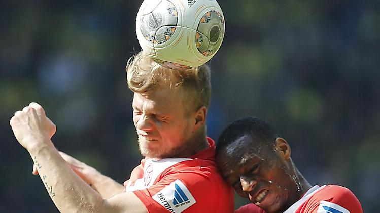 Mainz's Johannes Geis, rear, Mainz's Junior Diaz of Costa Rica, right, and Dortmund's Milos Jojic of Serbia challenge for the ball during the German first division Bundesliga soccer match between BvB Borussia Dortmund and Mainz 05 in Dortmund, Germany, Saturday, April 19, 2014