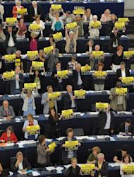 "Members of the European parliament hold up placards reading ""Hello democracy, goodbye ACTA"" as they vote to throw out threw out the controversial global pact to battle counterfeiting and online piracy, quashing any EU ratification and possibly killing it for good"