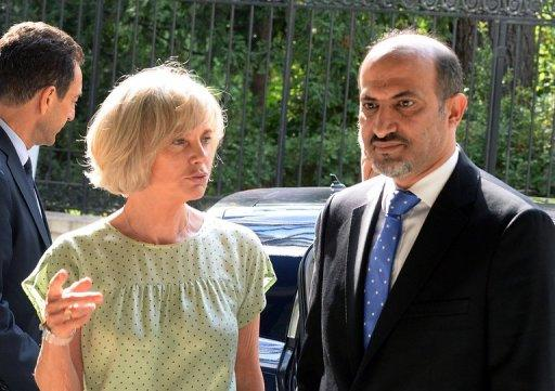 Syria's new opposition chief Ahmad Jarba is welcomed by Elisabeth Guigou, head of the French national assembly Foreign Affairs commitee, on July 23, 2013. Jarba is scheduled to meet French President Francois Hollande Wednesday, a day after asking France for military aid to boost the forces fighting the regime of President Bashar al-Assad