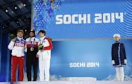 Men's 1,500-meter short track speedskating medalists, from left, Russia's Viktor Ahn, bronze, Canada's Charles Hamelin, gold, and China's Han Tianyu, silver, pose with their medals at the 2014 Winter Olympics in Sochi, Russia, Monday, Feb. 10, 2014. (AP Photo/Morry Gash)