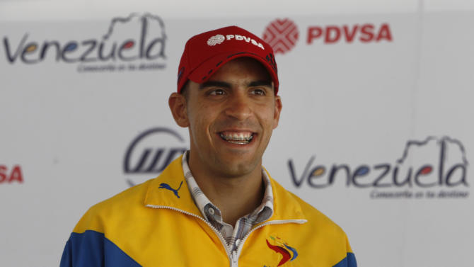 Williams' driver Pastor Maldonado, from Venezuela, smiles during a news conference in Caracas, Venezuela, Thursday, Jan. 6, 2011. Maldonado, 25, said he hopes to repeat his GP2 performance as he partners with Brazilian Rubens Barrichello at Formula One team Williams in 2011. Maldonado won the championship in GP2, which acts as a feeder series to F1. (AP Photo/Fernando Llano)