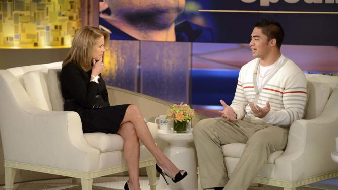 "This Jan. 22, 2013 photo released by ABC Notre Dame linebacker Manti Te'o, right, speaking with host Katie Couric during an interview for ""Katie,"" in New York. Te'o has told Katie Couric that he briefly lied about his online girlfriend after discovering she didn't exist, while maintaining that he had no part in creating the hoax. Pressed by Couric to admit that he was in on the deception, Te'o said he believed that his girlfriend Lennay Kekua had died of cancer and didn't lie about it until December. The interview will air on Thursday, Jan. 24.  (AP Photo/Disney-ABC, Lorenzo Bevilaqua)"