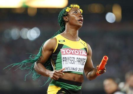Fraser Pryce of Jamaica crosses to finish line to win the women's 4x100m relay during the 15th IAAF World Championships at the National Stadium in Beijing