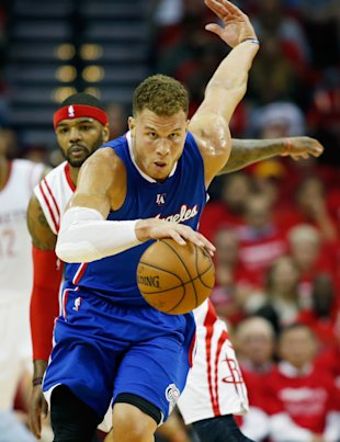 HOUSTON, TX - MAY 04:  Blake Griffin #32 of the Los Angeles Clippers drives past Josh Smith #5 of the Houston Rockets  during Game One in the Western Conference Semifinals of the 2015 NBA Playoffs on May 4, 2015 at the Toyota Center in Houston, Texas. NOTE TO USER: User expressly acknowledges and agrees that, by downloading and/or using this photograph, user is consenting to the terms and conditions of the Getty Images License Agreement.  (Photo by Scott Halleran/Getty Images)