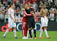 """Bayern midfielder Bastian Schweinsteiger (2nd L) embraces teammate and Dutch midfielder Arjen Robben after the friendly between Bayern and the Netherlands in Munich, southern Germany, on May 22. Netherlands coach Bert van Marwijk has strongly criticised the """"scandalous"""" treatment of Robben during the Oranje's friendly against his club Bayern"""