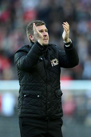 Karl Robinson, pictured, and Neal Ardley are proud of their fans following the FA Cup clash