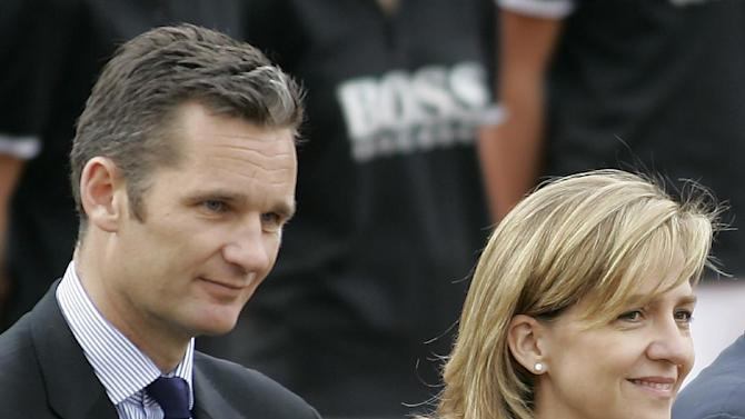 FILE- Spain's Princess Cristina, right, and her husband Inaki Urdangarin, left, are seen during the Barcelona Open Tennis Tournament final match in Barcelona, Spain, in this file photo dated Sunday, April 26, 2009.  A Spanish court has named the king's daughter Princess Cristina Wednesday April 3, 2013, as a suspect in an alleged corruption case involving her husband, and the court has announced that it will call her for questioning. The Spanish royal palace refused to comment Wednesday. (AP Photo/ David Ramos, File)