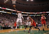 "Boston Celtics' Rajon Rondo shoots during game seven of their NBA Eastern Conference second-round series on May 26. The Celtics punched their ticket to the finals with an 85-75 victory over Philadelphia behind a ""triple-double"" by Rondo"