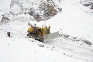 A photo issued by Pakistan's Inter Services Public Relations on Thursday shows army personnel using heavy machinery to remove snow as they search for avalanche victims. Pakistani troops have began excavating a new site in their search for 138 people buried by an avalanche at a high-altitude army camp despite a fresh slide in the area, the military said on Saturday