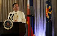 Philippine President Benigno Aquino addresses officials and Muslim rebels before the signing of the framework of agreement for peace, at Malacanang Palace in Manila, on October 15, 2012. Aquino on Monday paid a historic visit to the stronghold of Muslim rebels and said peace talks with them must be speeded up